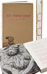 Design-Notizbuch und der pinke Faden im Druck